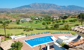 Bargain penthouse apartment for sale on Golf resort in Mijas, Costa del Sol 1