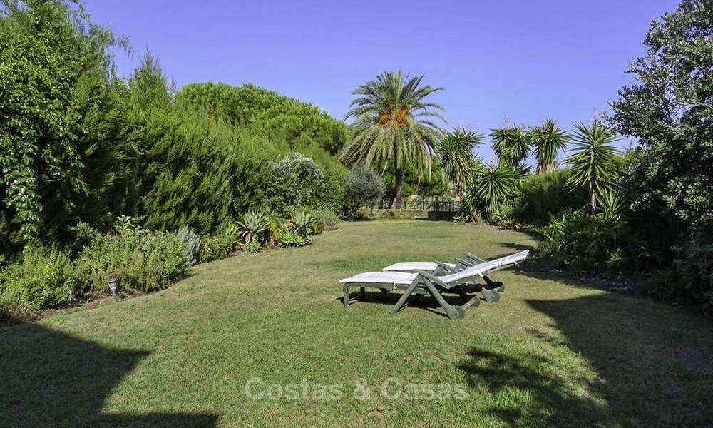 Cozy semi-detached villa for sale on first line golf in Marbella West 14107