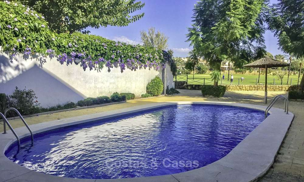 Cozy semi-detached villa for sale on first line golf in Marbella West 14114