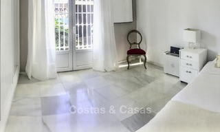 Cozy semi-detached villa for sale on first line golf in Marbella West 14118