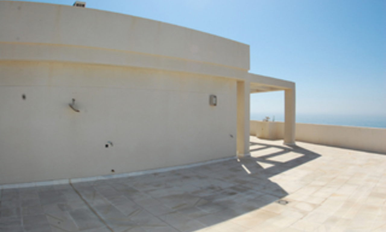 New frontline beach penthouse for sale, on the boulevard in the centre of Estepona 1
