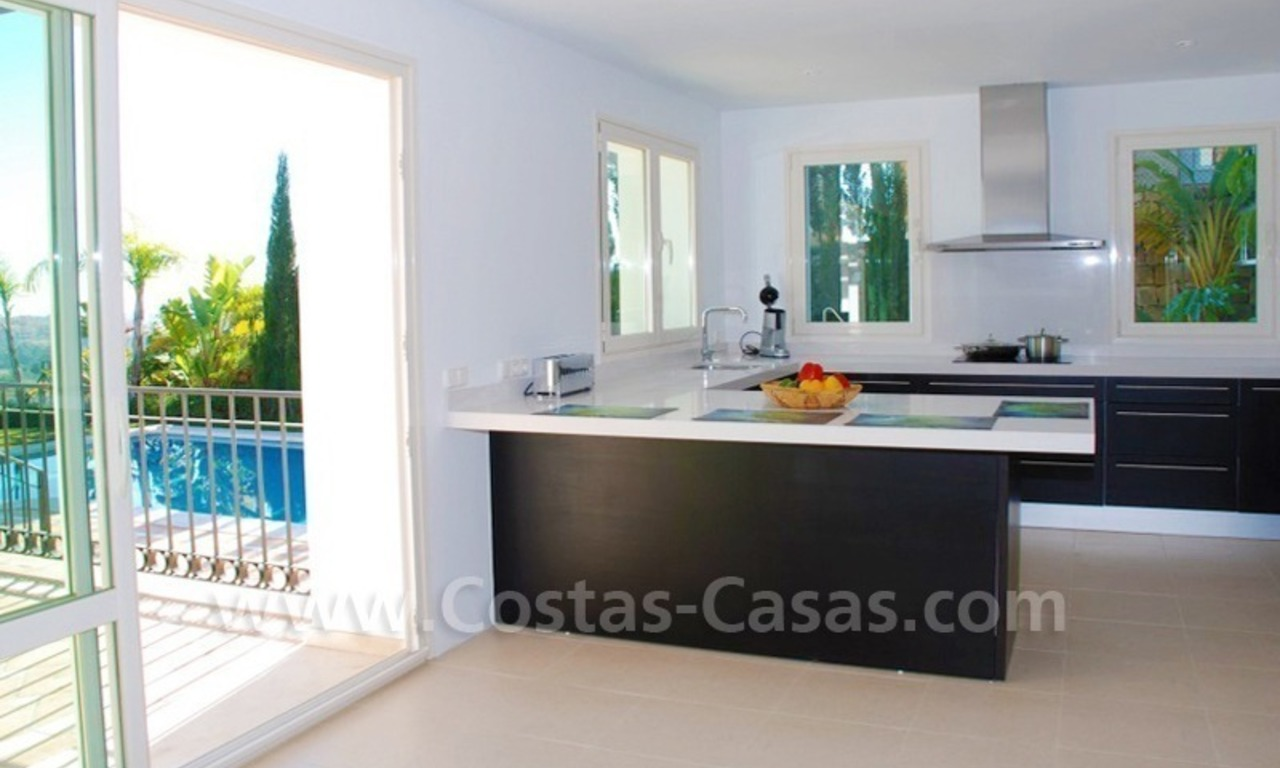 Luxury front line golf villa for sale in Marbella - Benahavis with spectacular views to the sea, golf and mountains 11
