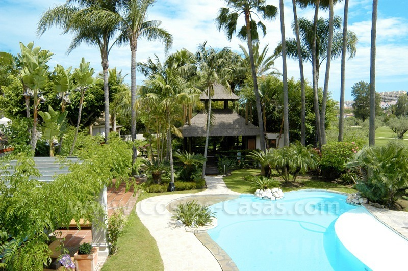 Exclusive front line golf Bali styled villa for sale in Nueva Andalucía, Marbella 1
