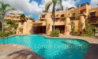 Exclusive modern andalusian styled townhouses for sale close to East Marbella at the Costa del Sol 0