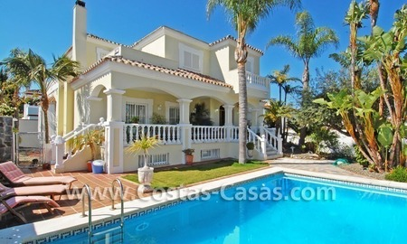 Modern Andalusian styled beachside villa for sale in Marbella 0