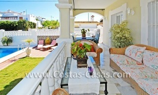 Modern Andalusian styled beachside villa for sale in Marbella 1