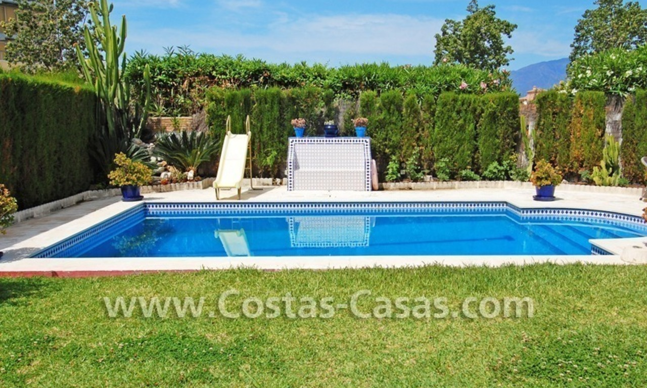 Andalusian styled beachside villa for sale in complex of villas in Marbella west 1