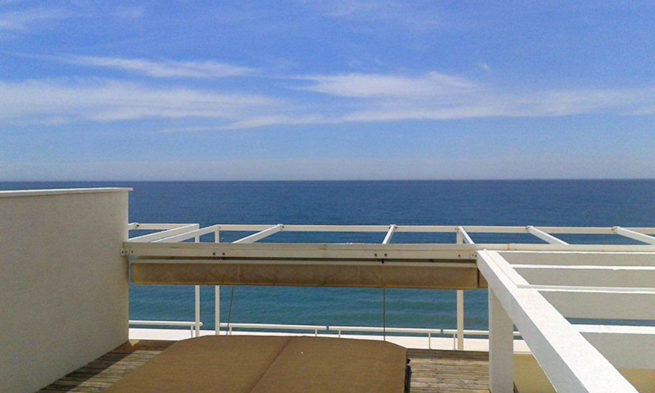 Large double penthouse for sale, frontline beach, between Marbella and Estepona 0