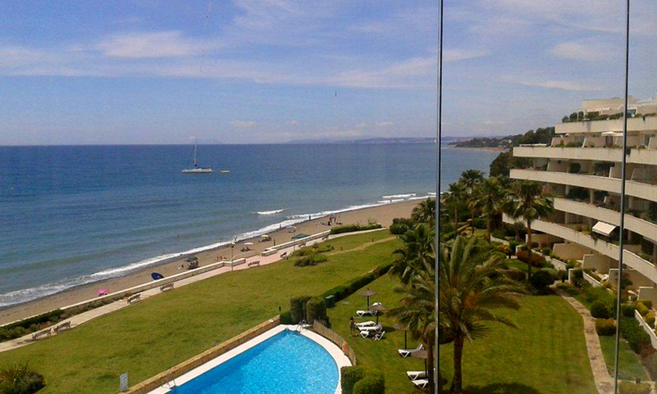 Large double penthouse for sale, frontline beach, between Marbella and Estepona 1