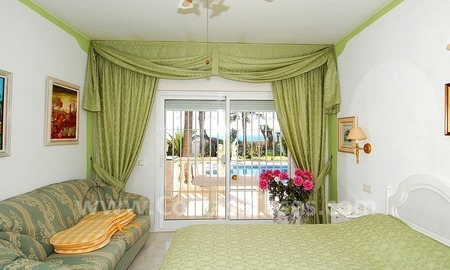First line beach villa with 2 guest houses for sale in East Marbella 16
