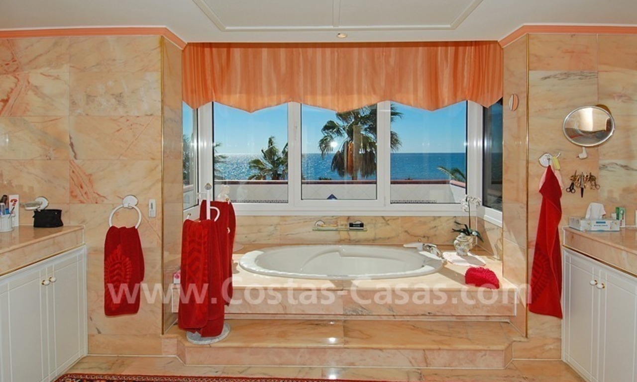 First line beach villa with 2 guest houses for sale in East Marbella 19