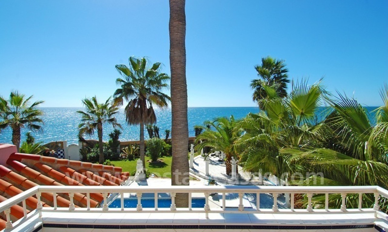 First line beach villa with 2 guest houses for sale in East Marbella 21