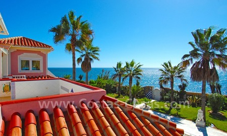 First line beach villa with 2 guest houses for sale in East Marbella 22