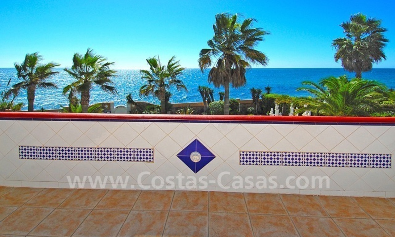 First line beach villa with 2 guest houses for sale in East Marbella 23