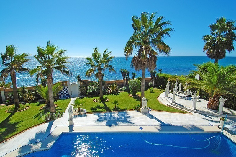 First line beach villa with 2 guest houses for sale in East Marbella
