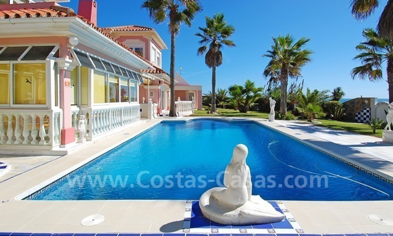 First line beach villa with 2 guest houses for sale in East Marbella 6
