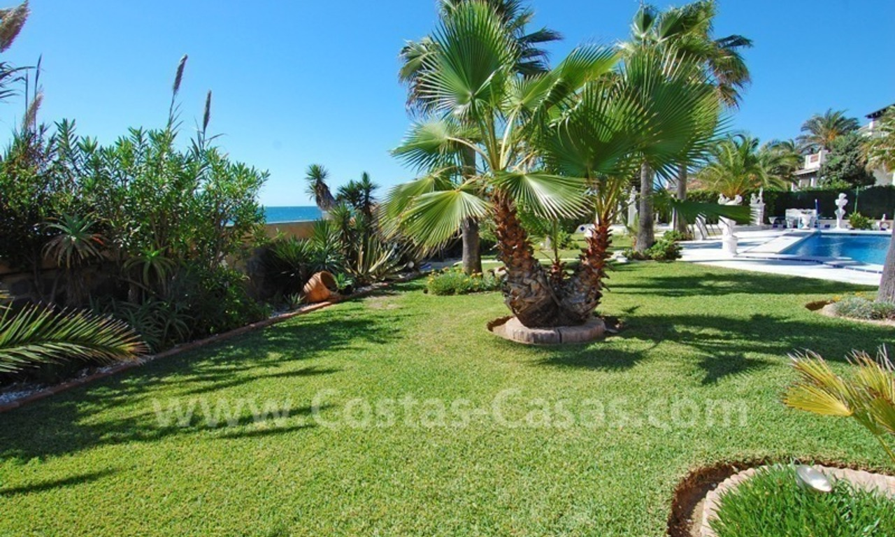 First line beach villa with 2 guest houses for sale in East Marbella 8