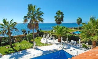 First line beach villa with 2 guest houses for sale in East Marbella 1