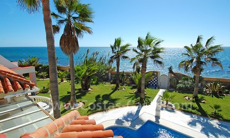 First line beach villa with 2 guest houses for sale in East Marbella 2