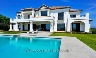 Contemporary Andalusian style luxury villa for sale at Golf Resort between Marbella and Estepona 1