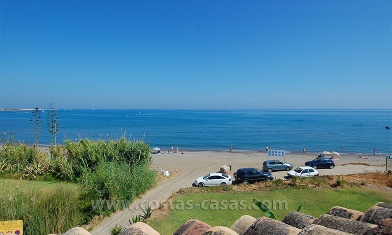 Frontline beach townhouse for sale in a first line beach complex in Estepona 0