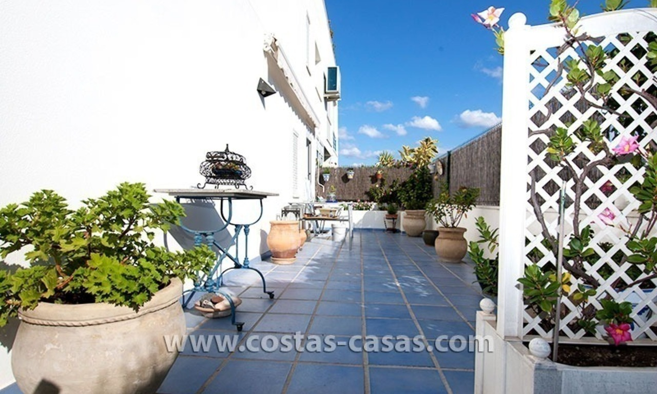 For Sale: Spacious ground floor apartment with private gardens in Nueva Andalucía, Marbella 1