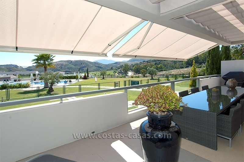 For Sale in the Marbella – Benahavís Area: Contemporary, Luxury Golf Apartment 1