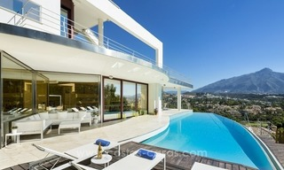 For Sale in Nueva Andalucia, Marbella: Designer Villa with panoramic golf, mountain and sea views 1