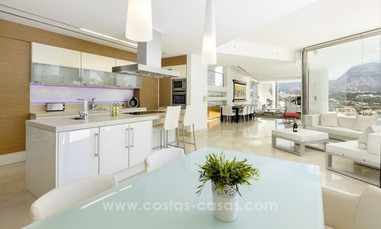 For Sale in Nueva Andalucia, Marbella: Designer Villa with panoramic golf, mountain and sea views 7