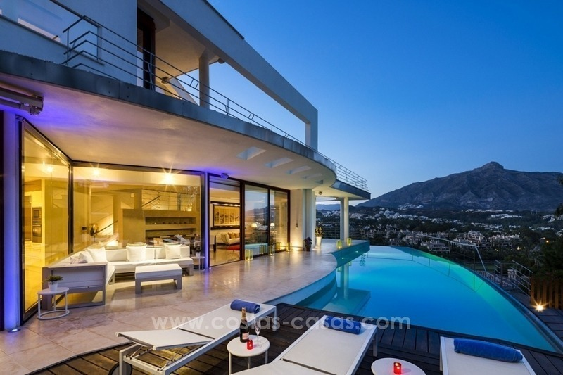 For Sale in Nueva Andalucia, Marbella: Designer Villa with panoramic golf, mountain and sea views