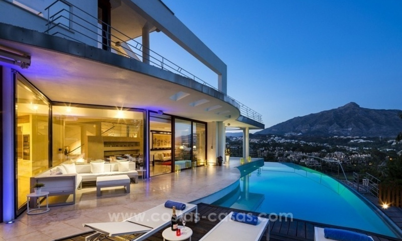 For Sale in Nueva Andalucia, Marbella: Designer Villa with panoramic golf, mountain and sea views 0