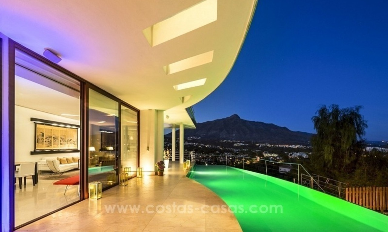 For Sale in Nueva Andalucia, Marbella: Designer Villa with panoramic golf, mountain and sea views 13