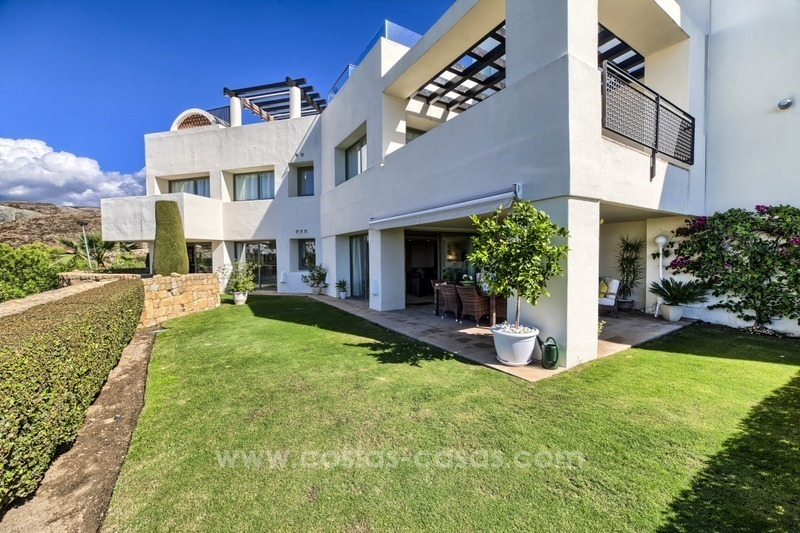 Modern luxury frontline golf ground floor apartment in a 5-star golf resort for sale in Benahavis - Marbella
