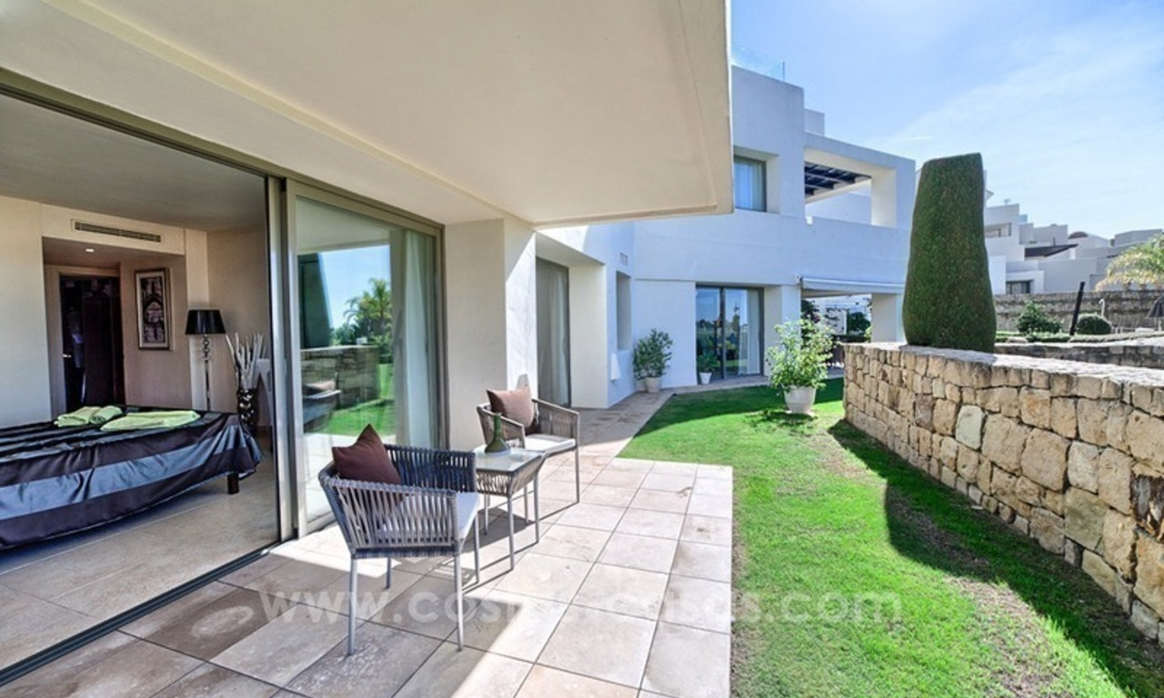 Modern luxury frontline golf ground floor apartment in a 5-star golf resort for sale in Benahavis - Marbella 1