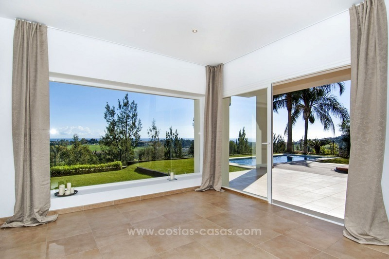 Front line golf, modern style villa for sale in Marbella - Benahavis with spectacular views to the sea, golf and mountains