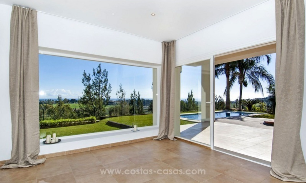 Front line golf, modern style villa for sale in Marbella - Benahavis with spectacular views to the sea, golf and mountains 0