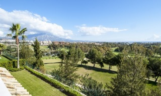 Front line golf, modern style villa for sale in Marbella - Benahavis with spectacular views to the sea, golf and mountains 1