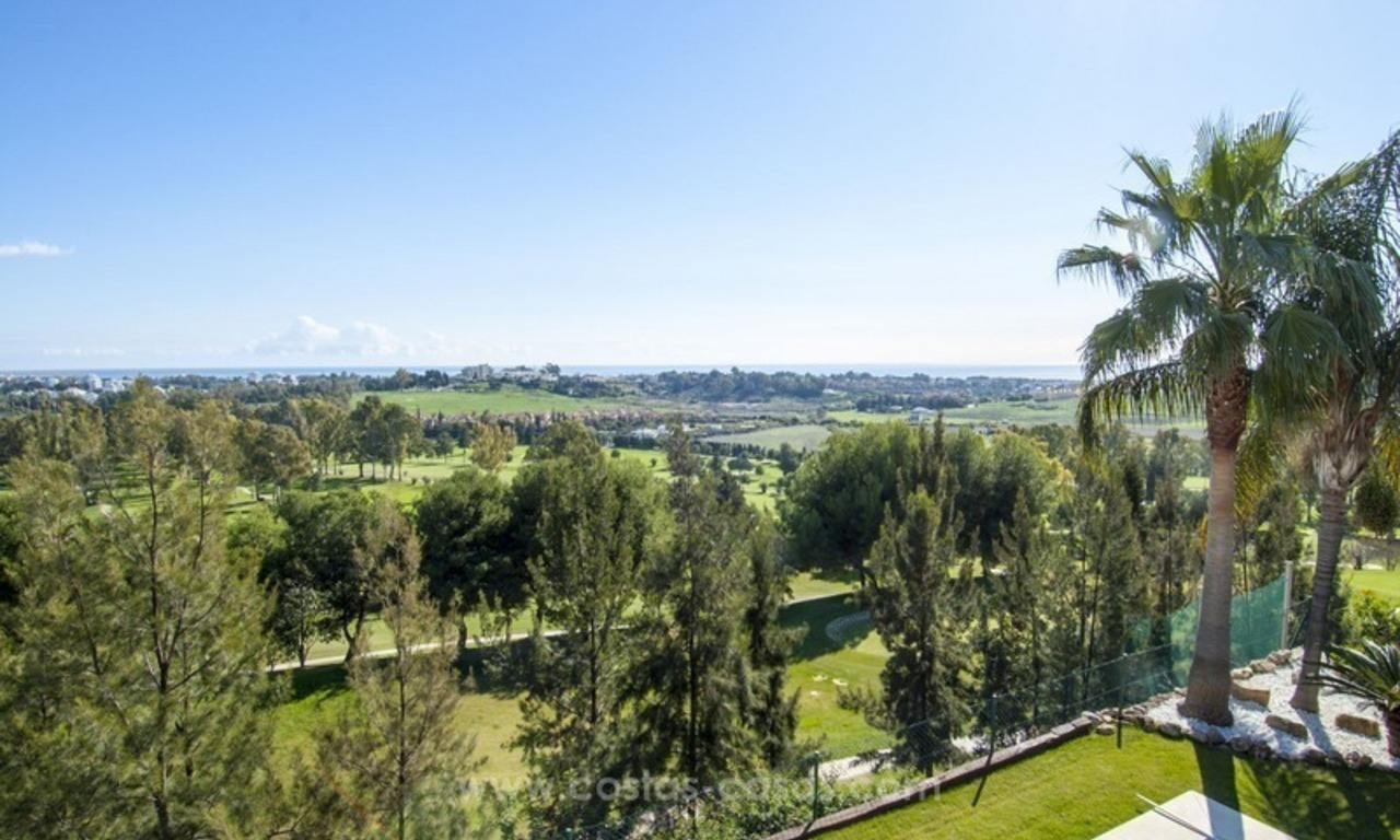 Front line golf, modern style villa for sale in Marbella - Benahavis with spectacular views to the sea, golf and mountains 4