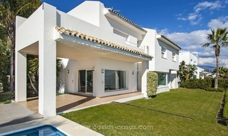 Front line golf, modern style villa for sale in Marbella - Benahavis with spectacular views to the sea, golf and mountains 10