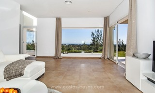 Front line golf, modern style villa for sale in Marbella - Benahavis with spectacular views to the sea, golf and mountains 12