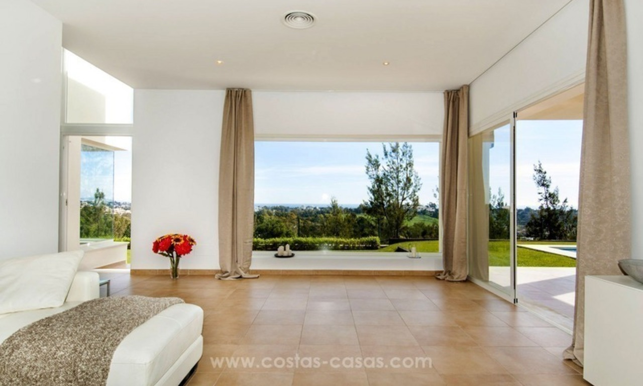 Front line golf, modern style villa for sale in Marbella - Benahavis with spectacular views to the sea, golf and mountains 13