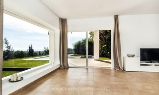 Front line golf, modern style villa for sale in Marbella - Benahavis with spectacular views to the sea, golf and mountains 15