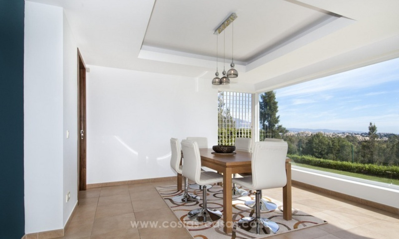 Front line golf, modern style villa for sale in Marbella - Benahavis with spectacular views to the sea, golf and mountains 18