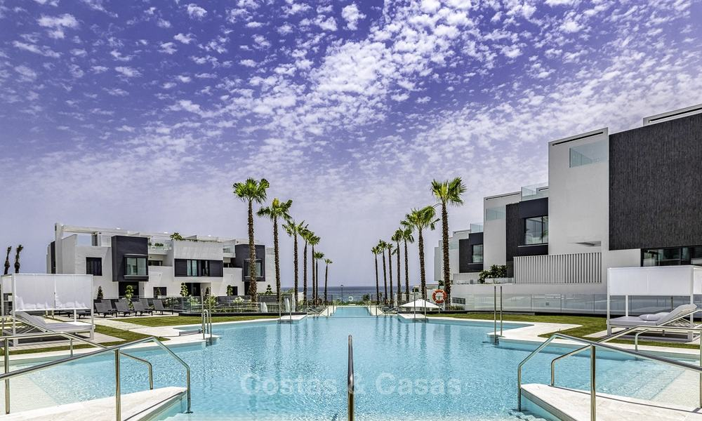 Modern new exclusive, move-in ready townhouses with sea view for sale, beachfront location, just minutes from Estepona centre 18603