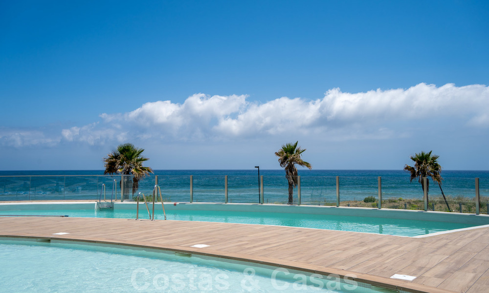 Spectacular modern luxury frontline beach apartments for sale in Estepona, Costa del Sol. Ready to move in. 27754