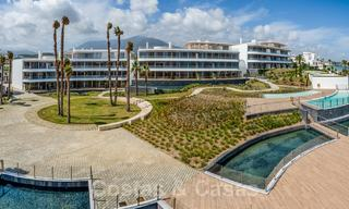 Spectacular modern luxury frontline beach apartments for sale in Estepona, Costa del Sol. Ready to move in. 27755