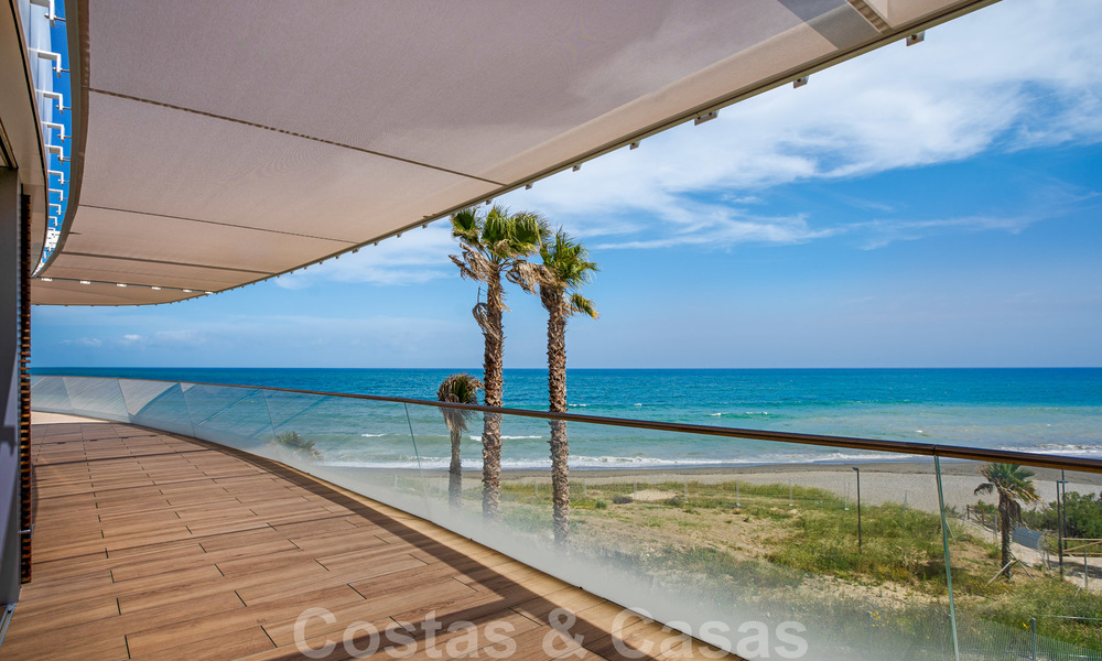 Spectacular modern luxury frontline beach apartments for sale in Estepona, Costa del Sol. Ready to move in. 27756