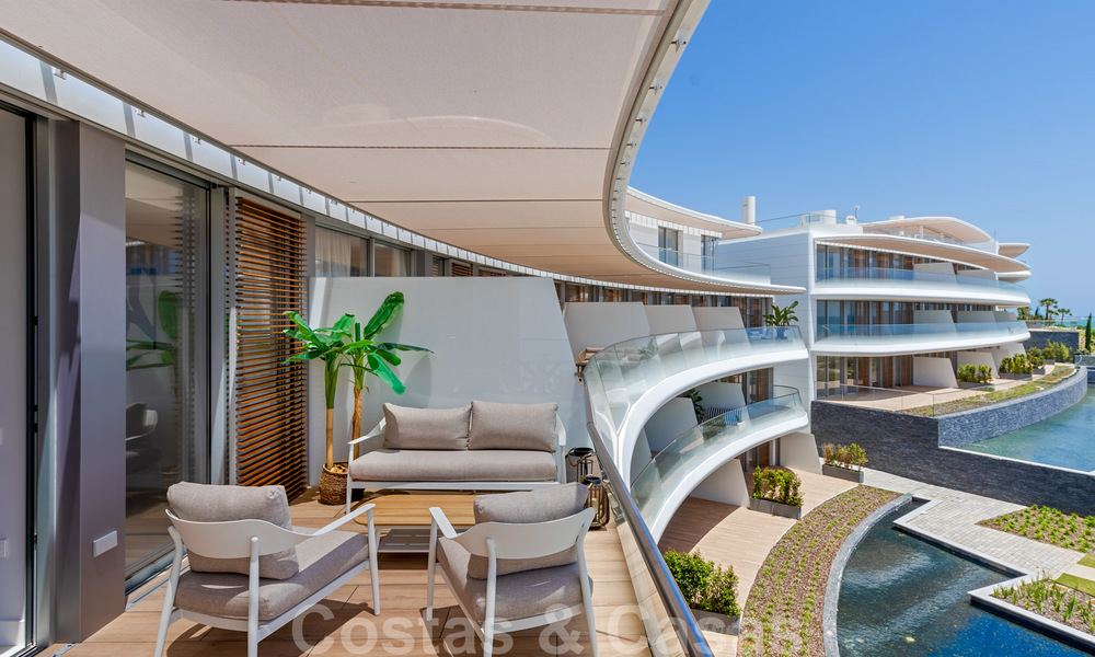 Spectacular modern luxury frontline beach apartments for sale in Estepona, Costa del Sol. Ready to move in. 27759