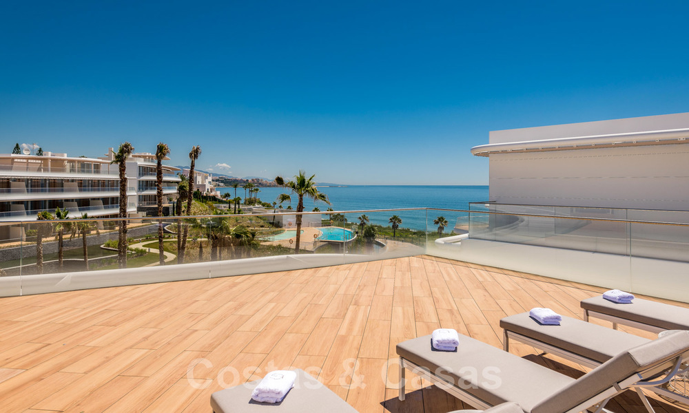 Spectacular modern luxury frontline beach apartments for sale in Estepona, Costa del Sol. Ready to move in. 27816