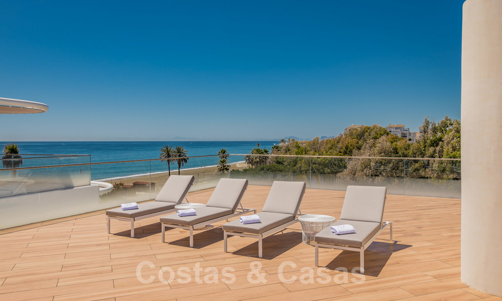 Spectacular modern luxury frontline beach apartments for sale in Estepona, Costa del Sol. Ready to move in. 27817